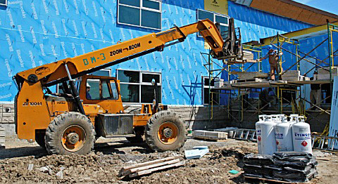 construction fork lift, construction workers, bricklayers, in progress, under construction, Primary school, Ottawa, Ontario, Canada